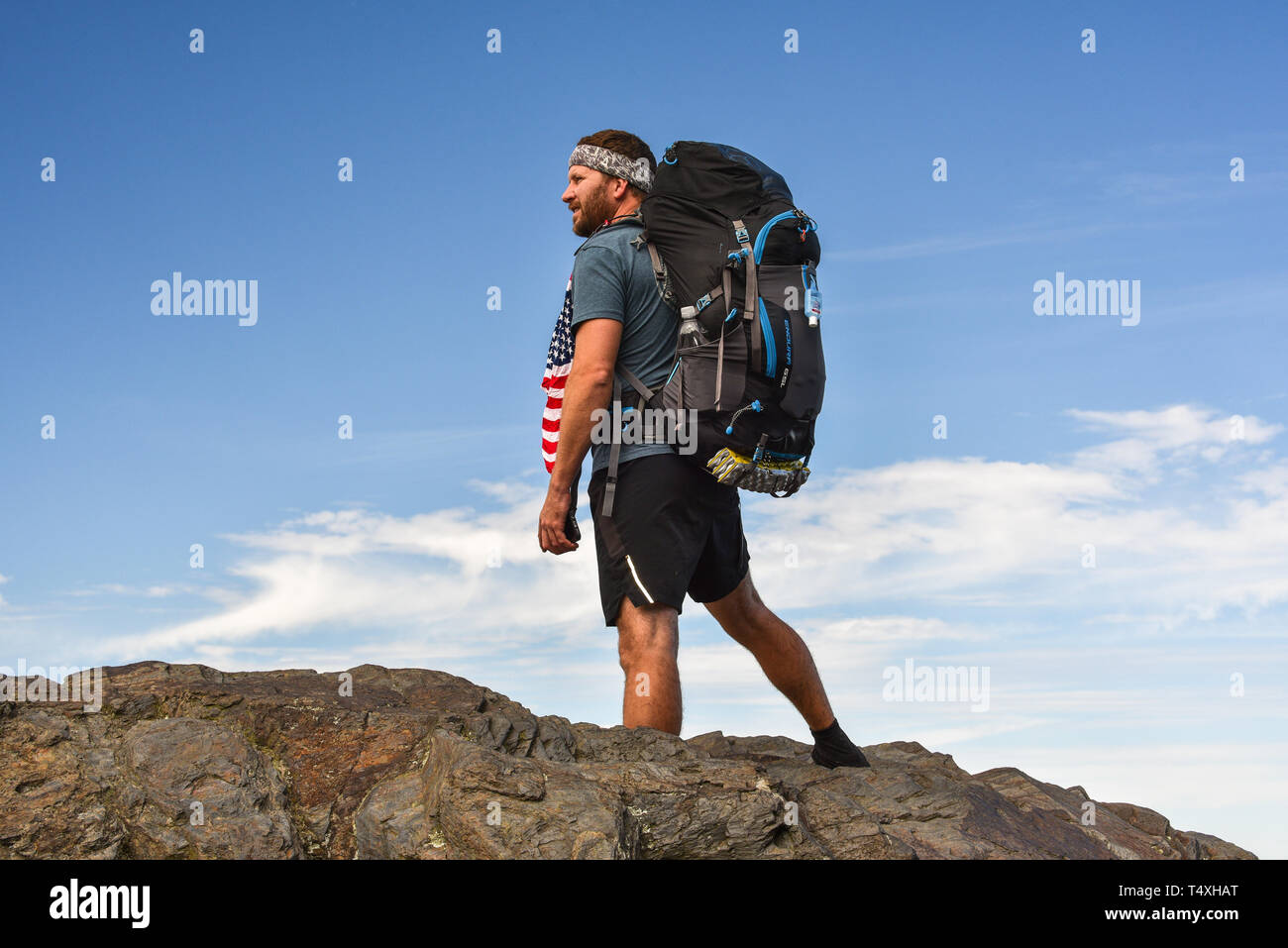 Rugged male backpacker hiking on Appalachian Trail, with pack, in the Great Smoky Mountains National Park in autumn, outside Gatlinburg, TN, USA Stock Photo