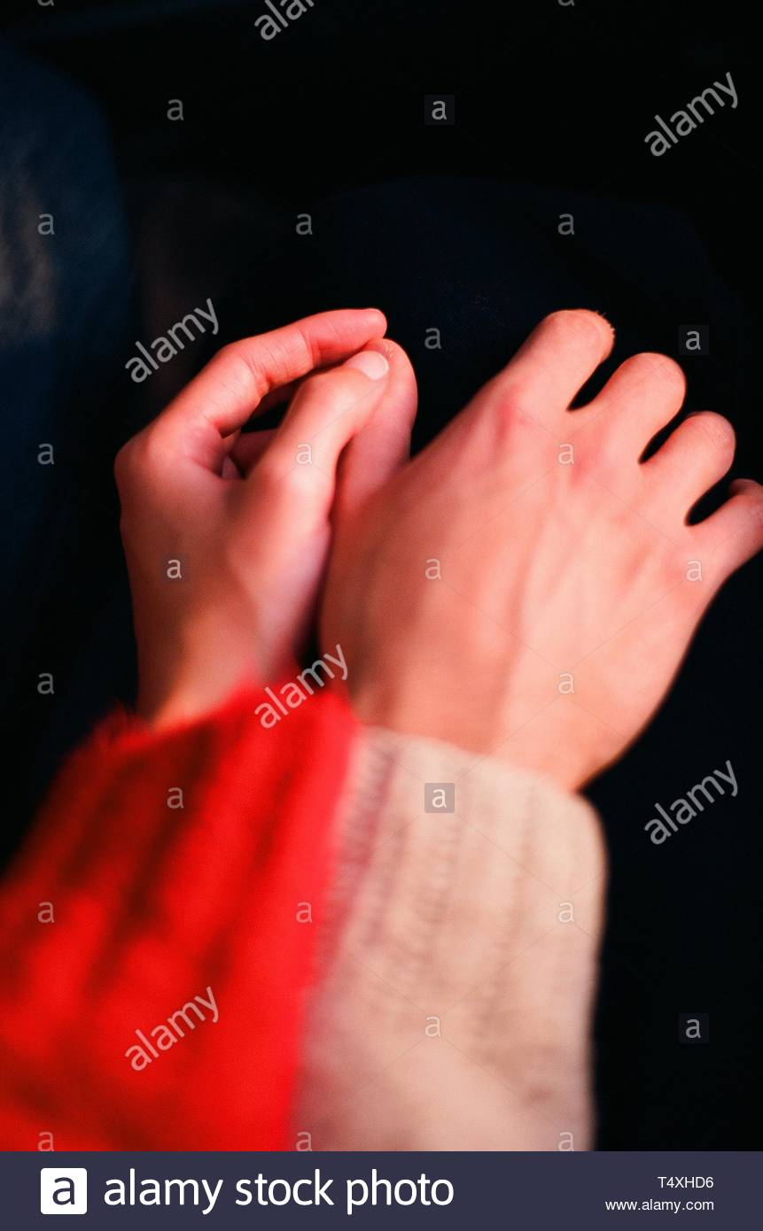 left hand touch hand - Stock Image