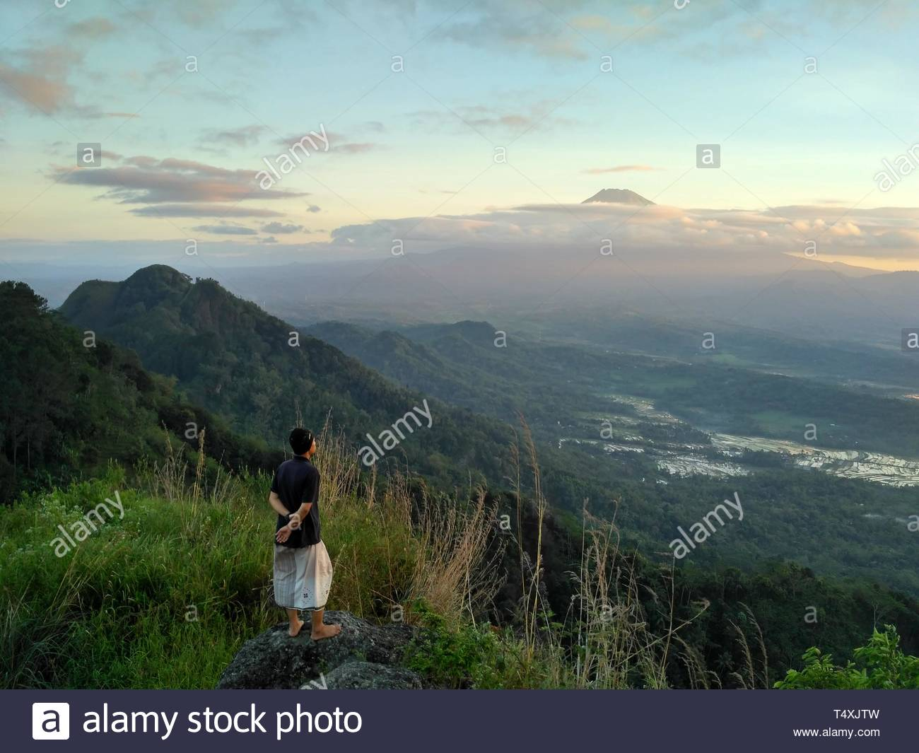 person on mountain rock - Stock Image