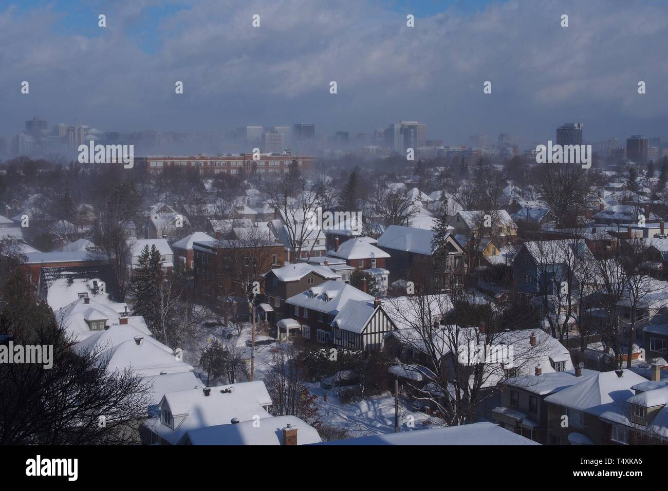 Despite a clear blue sky, a snow squall blankets downtown Ottawa during a polar vortex, Winter 2019. - Stock Image