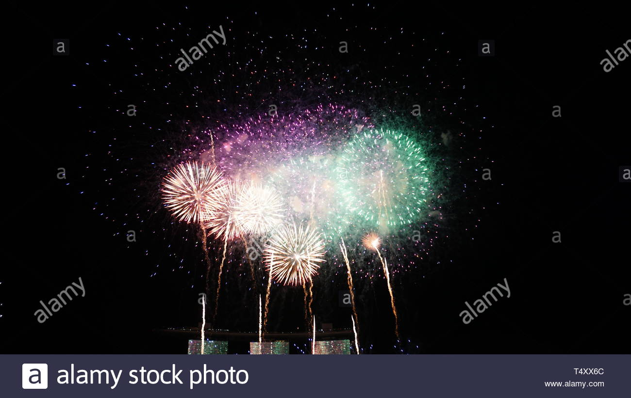 overlapping fireworks - Stock Image