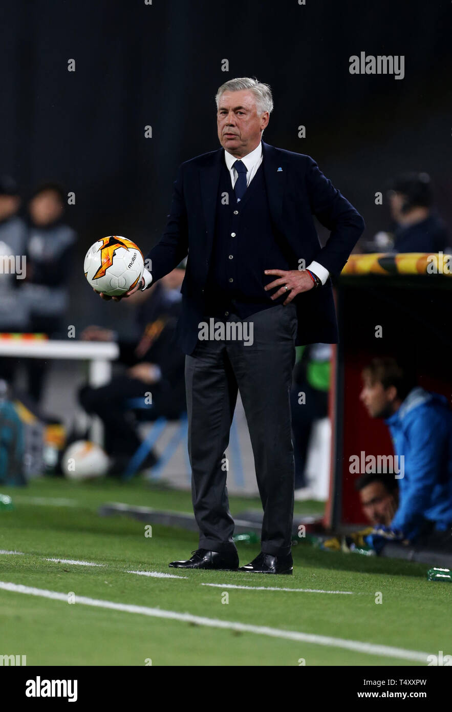 Napoli manager Carlo Ancelotti on the touchline during the UEFA Europa League quarter final second leg match at the San Paolo Stadium, Naples. Stock Photo