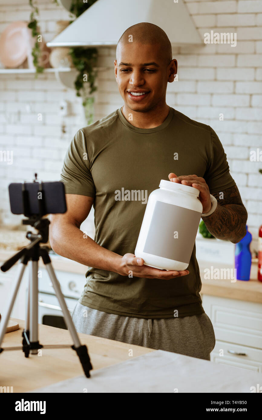 Sportsman making blog about protein for professional sportsmen - Stock Image