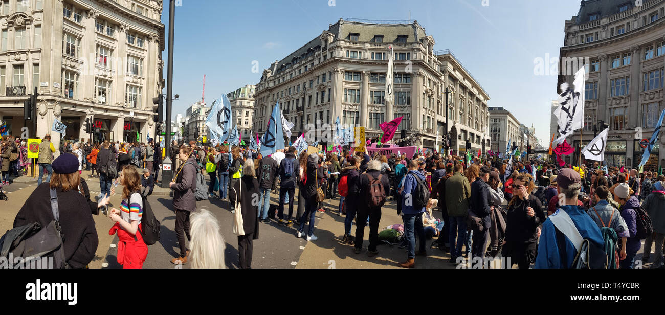 London, United Kingdom, April 15th 2019:- Extinction Rebellion protesters block in Oxford Circus in central London to protest the current environmenta Stock Photo