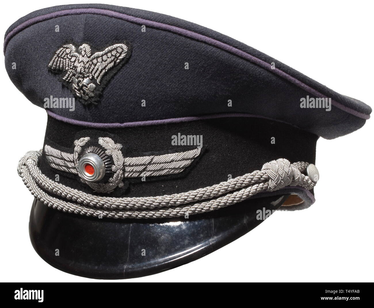 """A visor cap for leaders. Made of Luftwaffe blue gabardine, black cap band, violet piping, silver-embroidered RLB national emblem, the silver-embroidered wing with a metal cockade. Brown inner liner with celluloid trapezoid, silver imprinted RLB star, """"Gradgruppe 5-10"""" and a slide-in name tag """"Rudolf Abel"""". A very rare depot piece in only lightly worn condition. historic, historical, Reichsluftschutzbund, State Air Protection Corps, organisation, organization, organizations, organisations, NS, National Socialism, Nazism, Third Reich, German Reich, Germany, utilities, accesso, Editorial-Use-Only Stock Photo"""