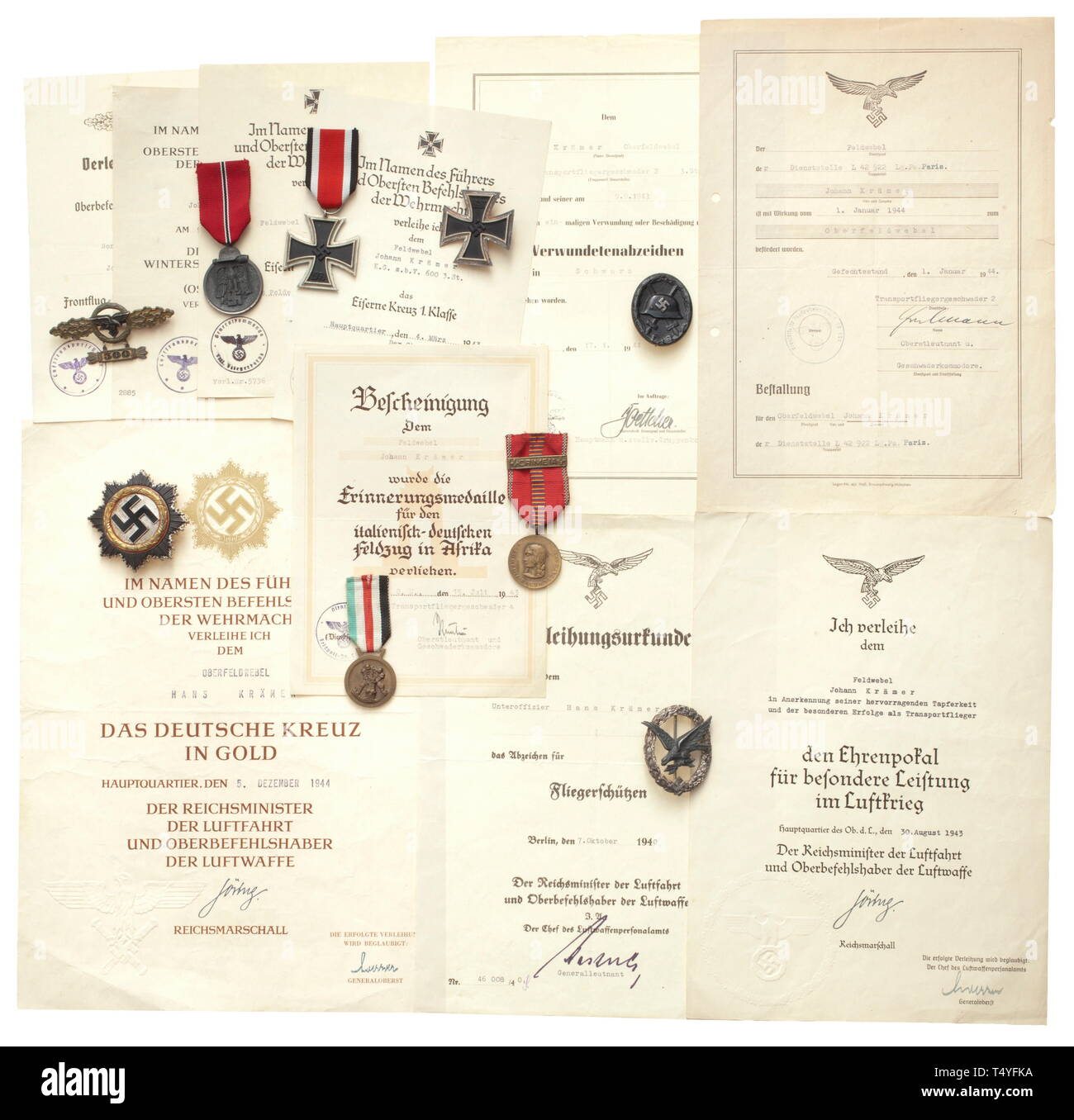 Awards and documents of a transport flyer. A German Cross in Gold, light issue with four rivets, the pin punched '20' on the underside, and large decorative document (folded, knocked) dated 5 December 1944 with blind-stamped Reich marshal eagle. Also an award document for the Goblet of Honour for Outstanding Achievement in the Air War dated 30 August 1943, and an award document for the Squadron Clasp in Gold for Transport Flyers dated 15 June 1942. Included are a Squadron Clasp in fine zinc issue (migrated) with '300' pendant as well as an Iron C, Additional-Rights-Clearance-Info-Not-Available - Stock Image