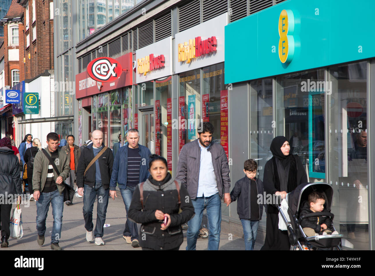 Pedestrians walking along the shops at High Road, Wembley - Stock Image