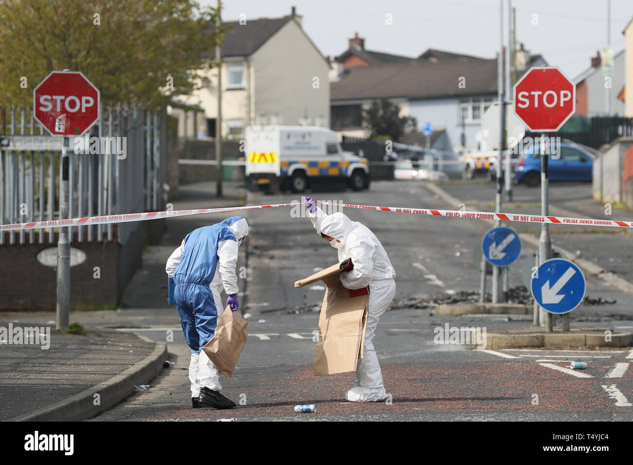 "Police forensic officers at the scene in Londonderry, Northern Ireland, where 29-year-old journalist Lyra McKee was shot and killed when guns were fired and petrol bombs were thrown in what police are treating as a ""terrorist incident"". Stock Photo"