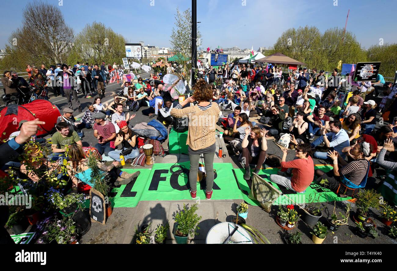Extinction Rebellion demonstrators hold a community meeting on Waterloo Bridge in London. Stock Photo