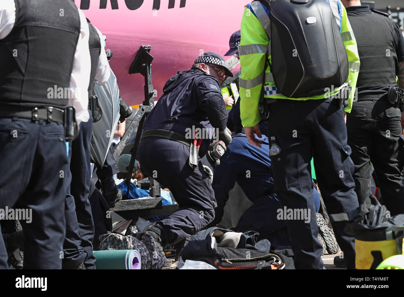 Police prepare to remove Extinction Rebellion demonstrators from the boat at Oxford Circus in London. Stock Photo