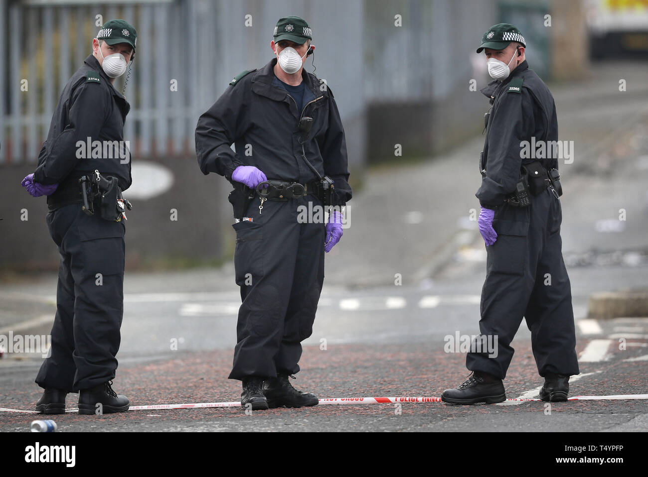 """Police at the scene in Londonderry, Northern Ireland, where 29-year-old journalist Lyra McKee was shot and killed when guns were fired and petrol bombs were thrown in what police are treating as a """"terrorist incident"""". Stock Photo"""