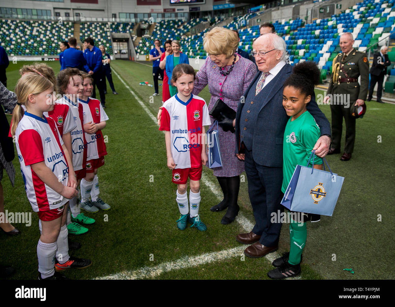 Irish President Michael D Higgins and his wife Sabina Coyne at pitch side in the National Stadium at Windsor Park, Belfast, meeting players from the Cliftonville and Linfield U9 girls' teams. Stock Photo