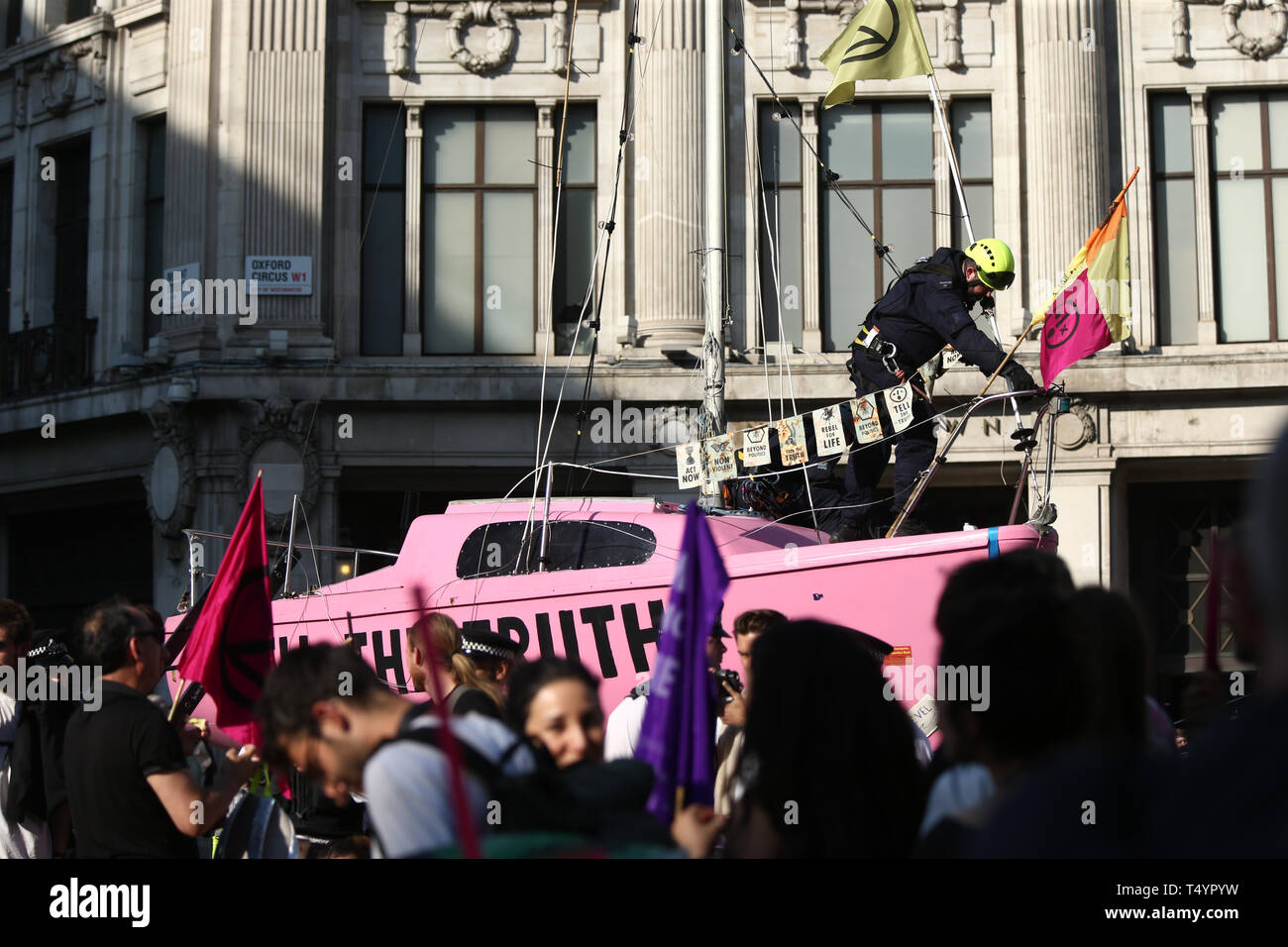 Police take control of Extinction Rebellion's 'Tell the Truth' boat, as protests continue at Oxford Circus in London. Stock Photo