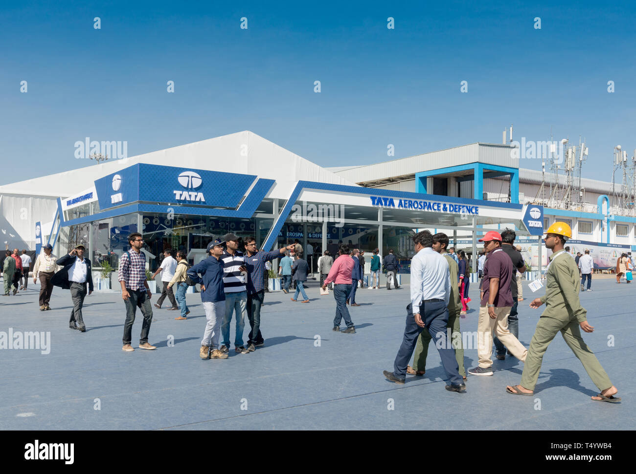 Bengaluru, India - February 22, 2019: Visitors outside the Tata Aerospace stall at the Aero India 2019. Aero India is a biennial air show and aviation - Stock Image