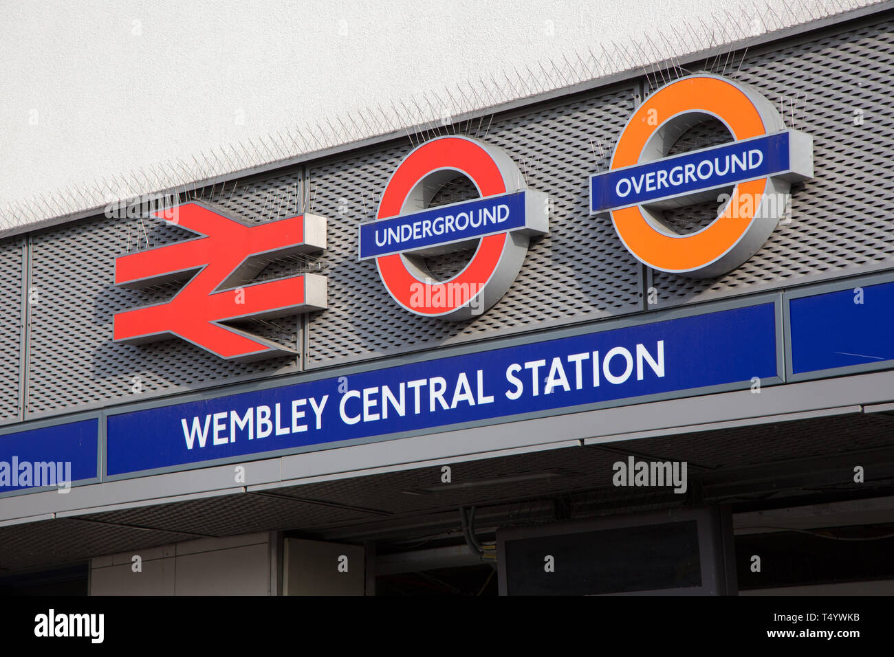 Wembley Central Station, close up of signs above entrance to Underground, Overground and rail station on High Road, Wembley - Stock Image