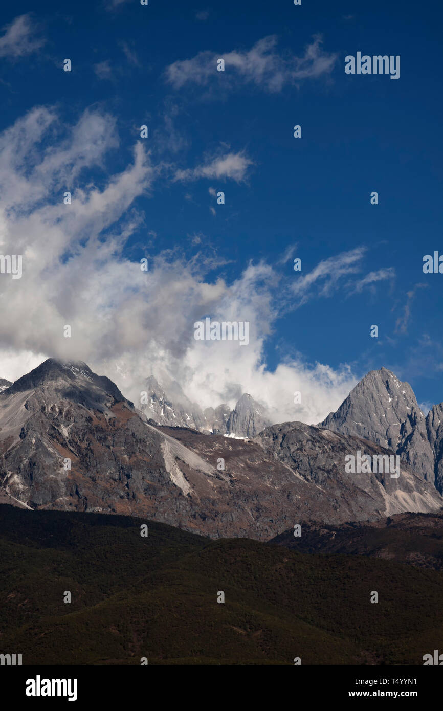Yulong Xueshan, Jade Dragon Snow Mountains is a mountain range near Lijiang in the northwest of Yunnan Province in the People's Republic of China - Stock Image