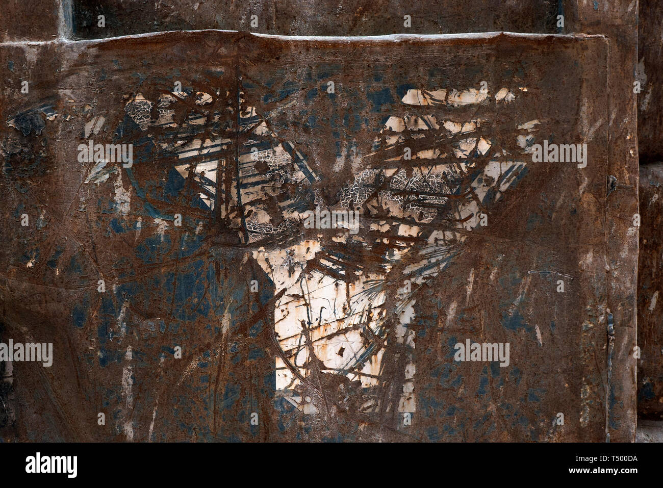 A Close Up Of The Letter Y On The Side Of A Rusty Metal Skip - Stock Image