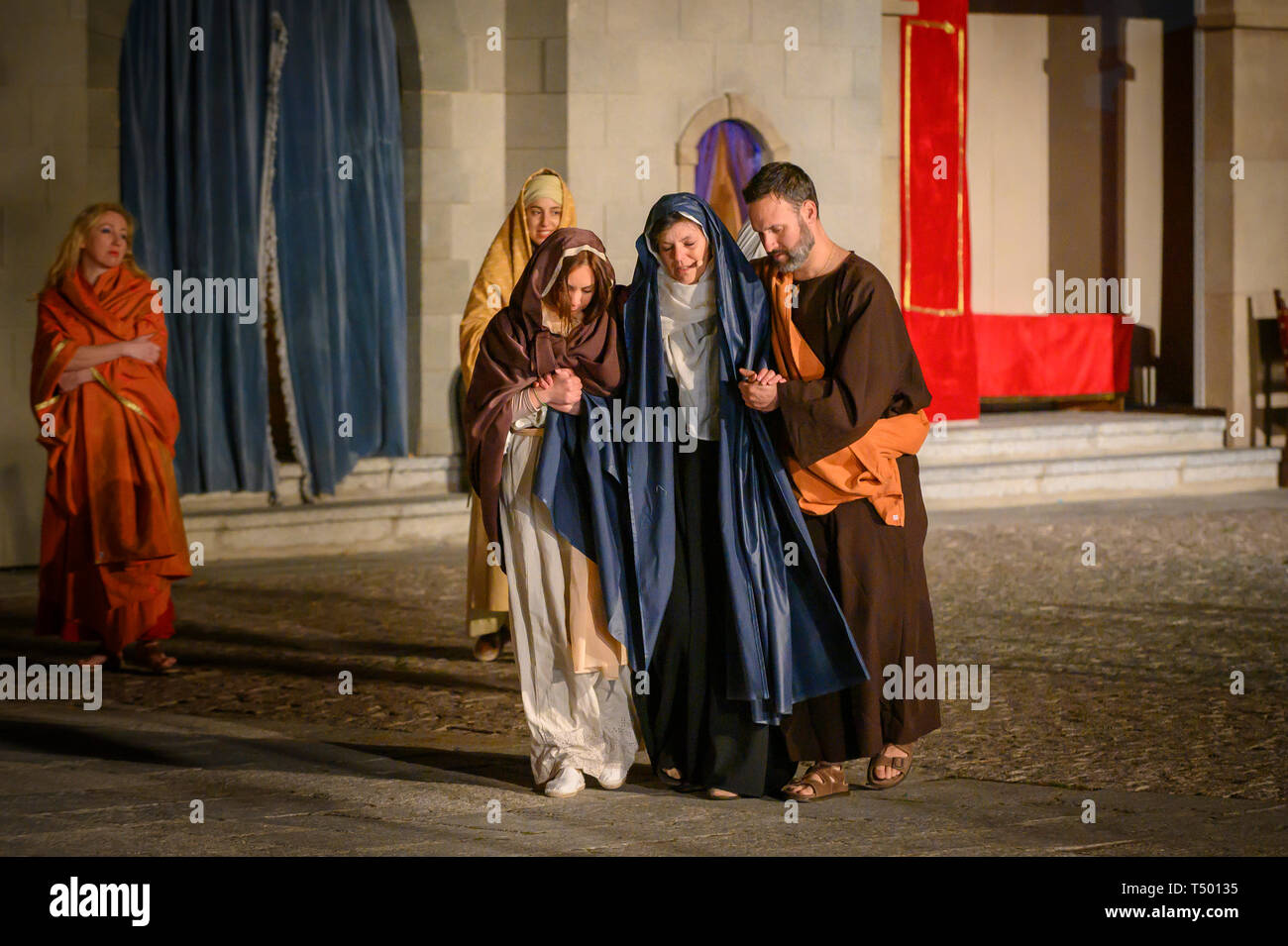 Brunete, Spain - April 11, 2019: Popular play of The Passion of Christ in the Plaza Mayor of the town. Virgin Mary consoled while condemning Jesus. - Stock Image
