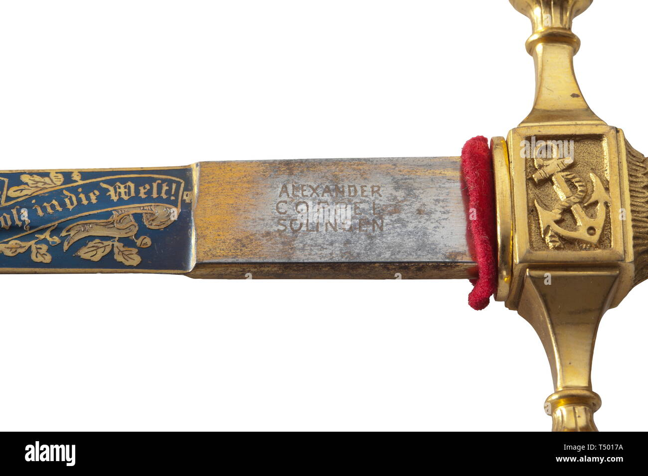 Count Felix von Luckner (1881 - 1966) - an honour dagger of the Luckner Society, Düsseldorf, patterned after the dagger for officers of the Imperial German navy, the blade with double fullers on each side, and etched, blued, and gilded (worn in places). It bears the manufacturer's stamp 'Alexander Coppel, Solingen' and Count von Luckner's family coat of arms framed by naval motifs along with the inscription (tr) 'Bravery Brings Renown - From German 20th century, Editorial-Use-Only - Stock Image