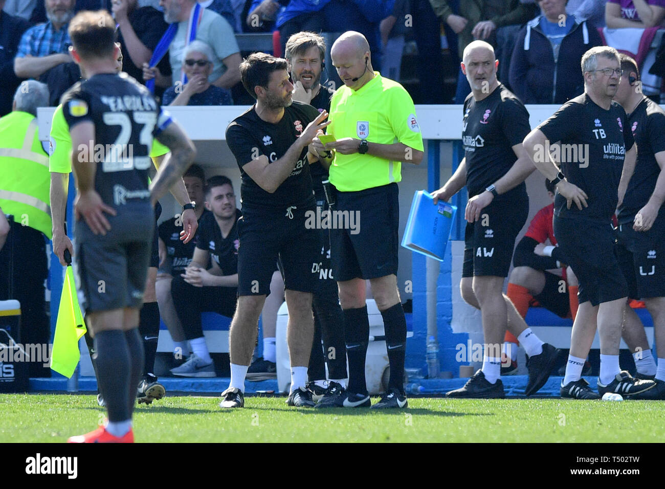 Lincoln City manager Danny Cowley speaks with Match referee