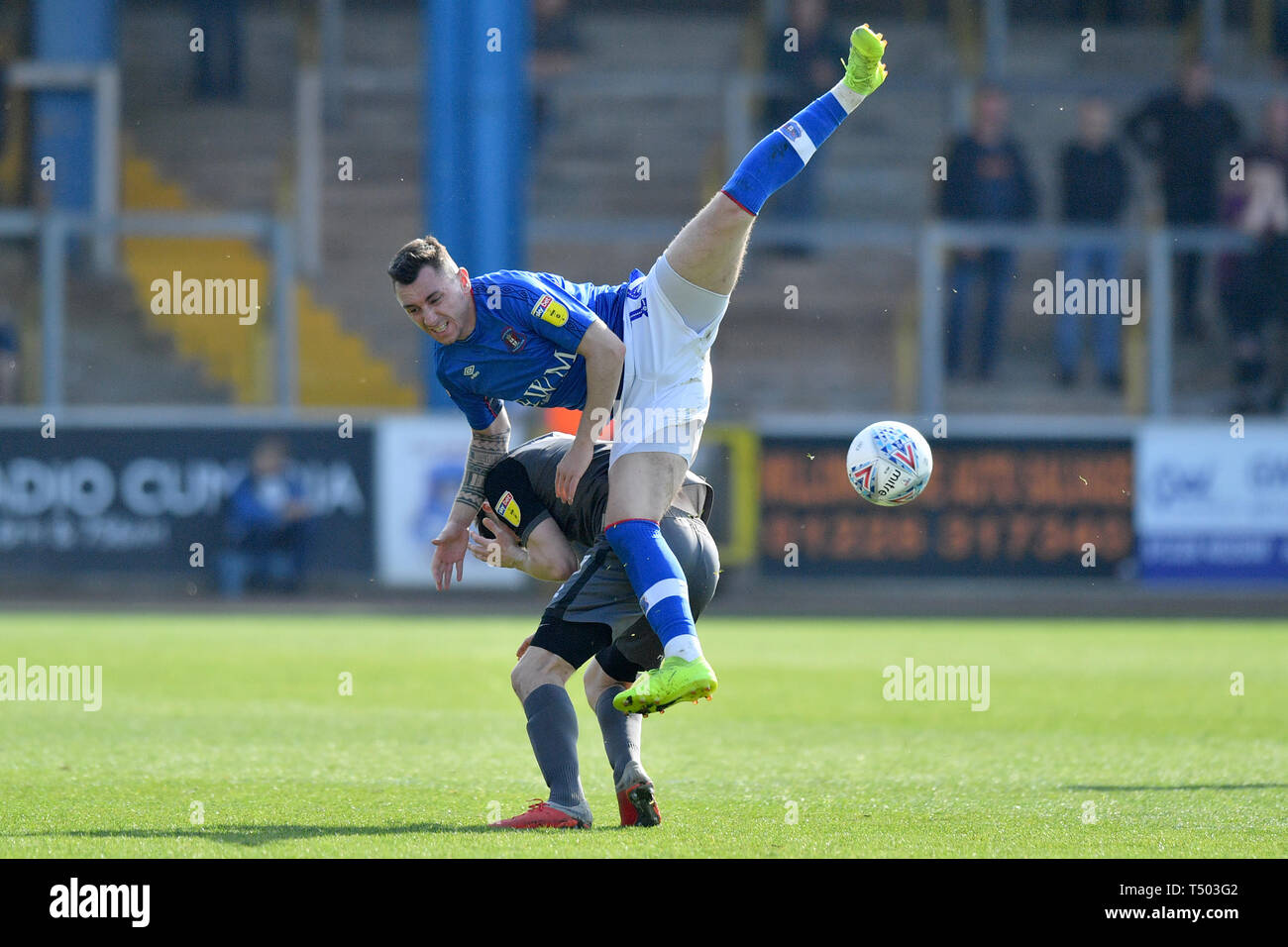 Carlisle United's Nathan Thomas and Lincoln City's Tom Prett compete for a header during the Sky Bet Championship match at Brunton Park, Carlisle. Stock Photo