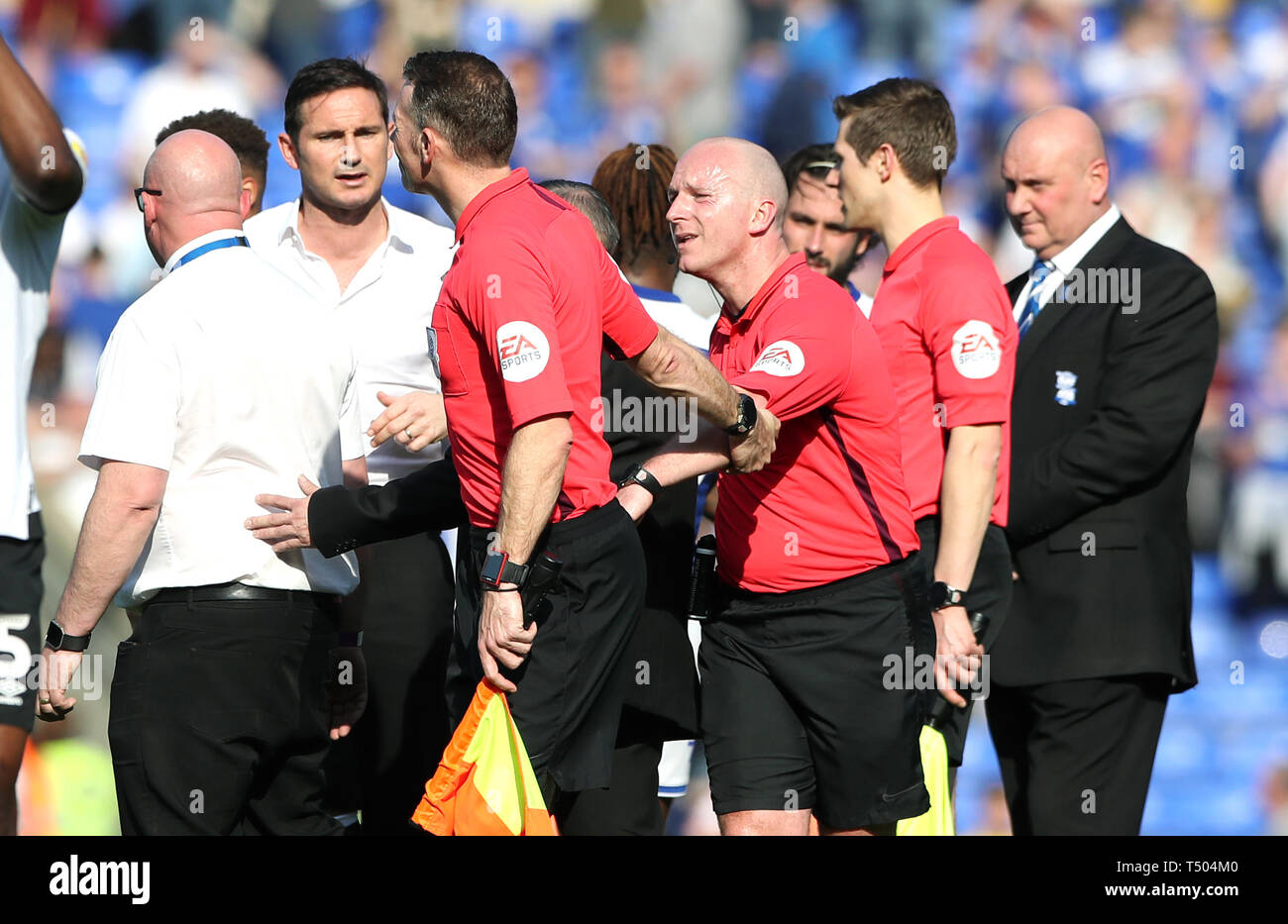 A match official pulls referee Simon Hooper away from Derby County manager Frank Lampard (second left) after exchanging words following the Sky Bet Championship match at St Andrew's Trillion Trophy Stadium, Birmingham. Stock Photo