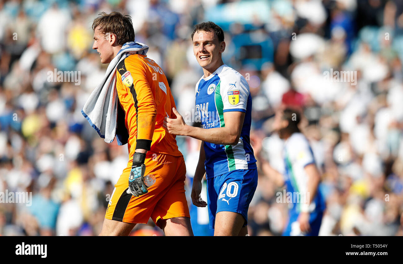 Wigan Athletic goalkeeper Christian Walton and Kal Naismith celebrate after their teams 2-1 win against Leeds United, during the Sky Bet Championship match at Elland Road, Leeds. Stock Photo