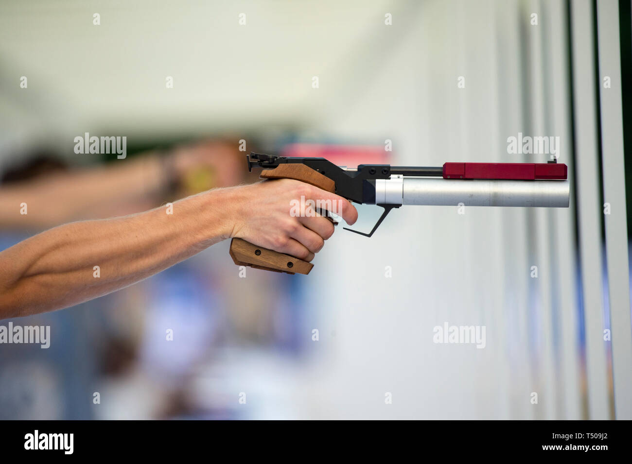 A man is shooting from a sports laser gun - Stock Image