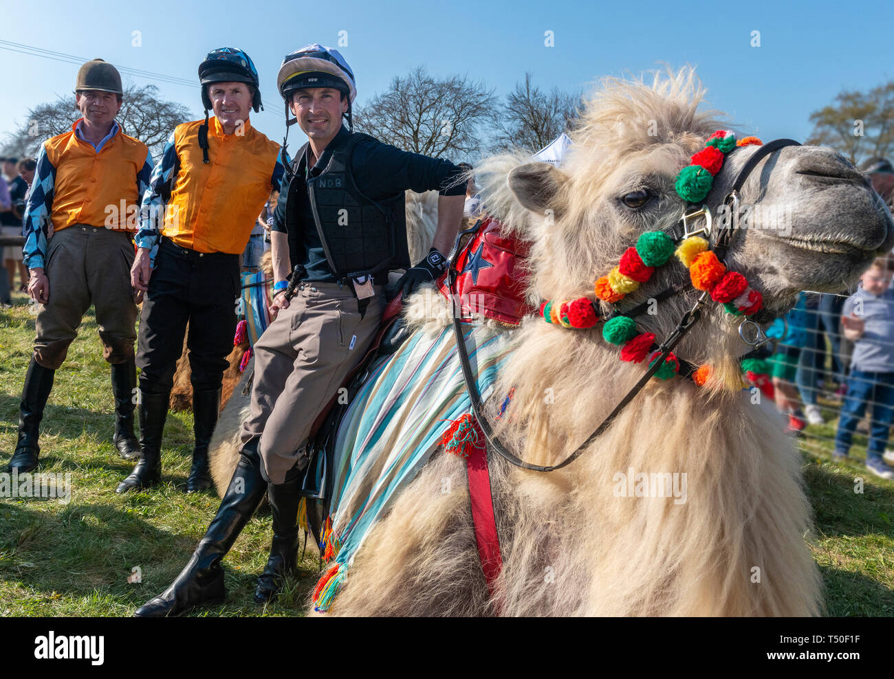 Hungerford, West Berkshire, UK. 19th Apr 2019. Melbourne 10 Racing Camel Racing winners AP McCoy (Sir Anthony Peter McCoy OBE, commonly known as AP McCoy ) former champion horse racing jockey Centre 1ST famous horse race trainer Jamie Osborne Left 2ND and Nico de Boinville racing jockey who competes in National Hunt racing. Stock Photo