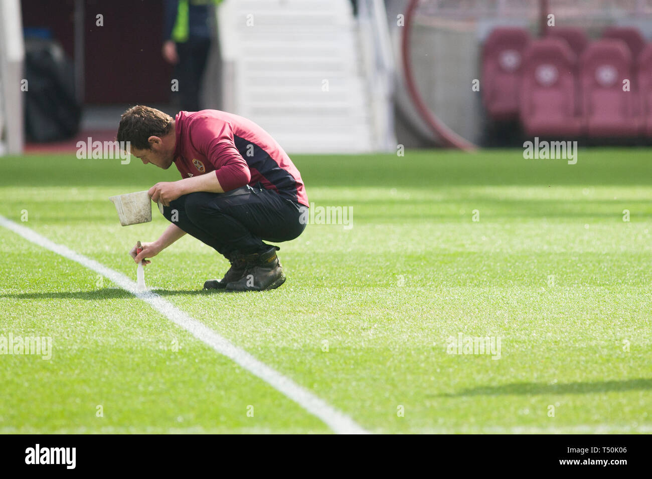 Edinburgh, UK. 20th Apr, 2019. A groundsman before the Ladbrokes Premiership match between Hearts and Rangers at Tynecastle Park on April 20 2019 in Edinbugh, UK. Credit: Scottish Borders Media/Alamy Live News - Stock Image