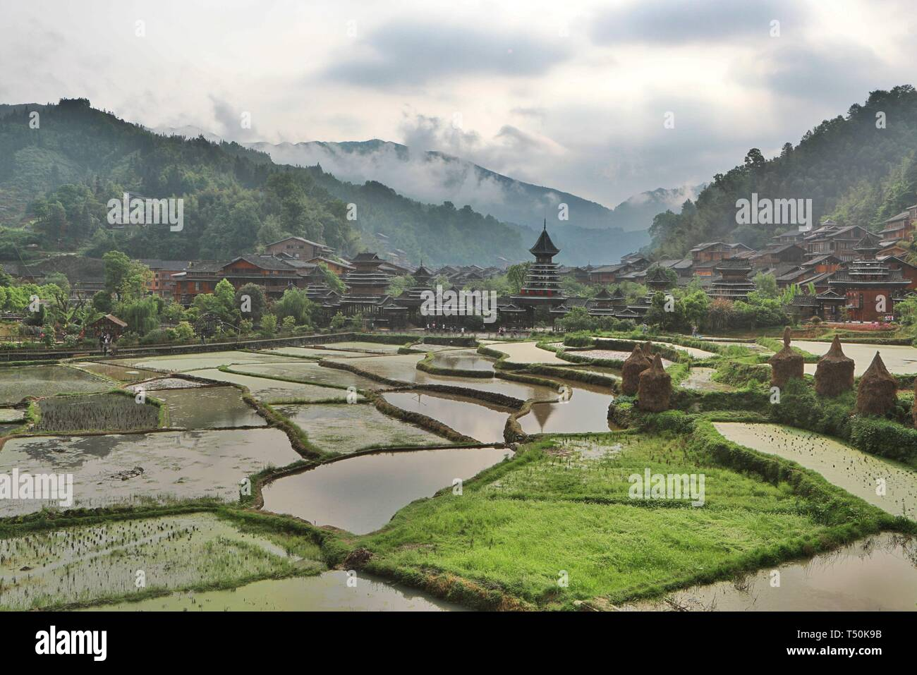 Liping. 20th Apr, 2019. Photo taken on April 20, 2019 shows the fog-shrouded Dong village of Zhaoxing, Liping County, southwest China's Guizhou Province. Credit: Ou Dongqu/Xinhua/Alamy Live News Stock Photo