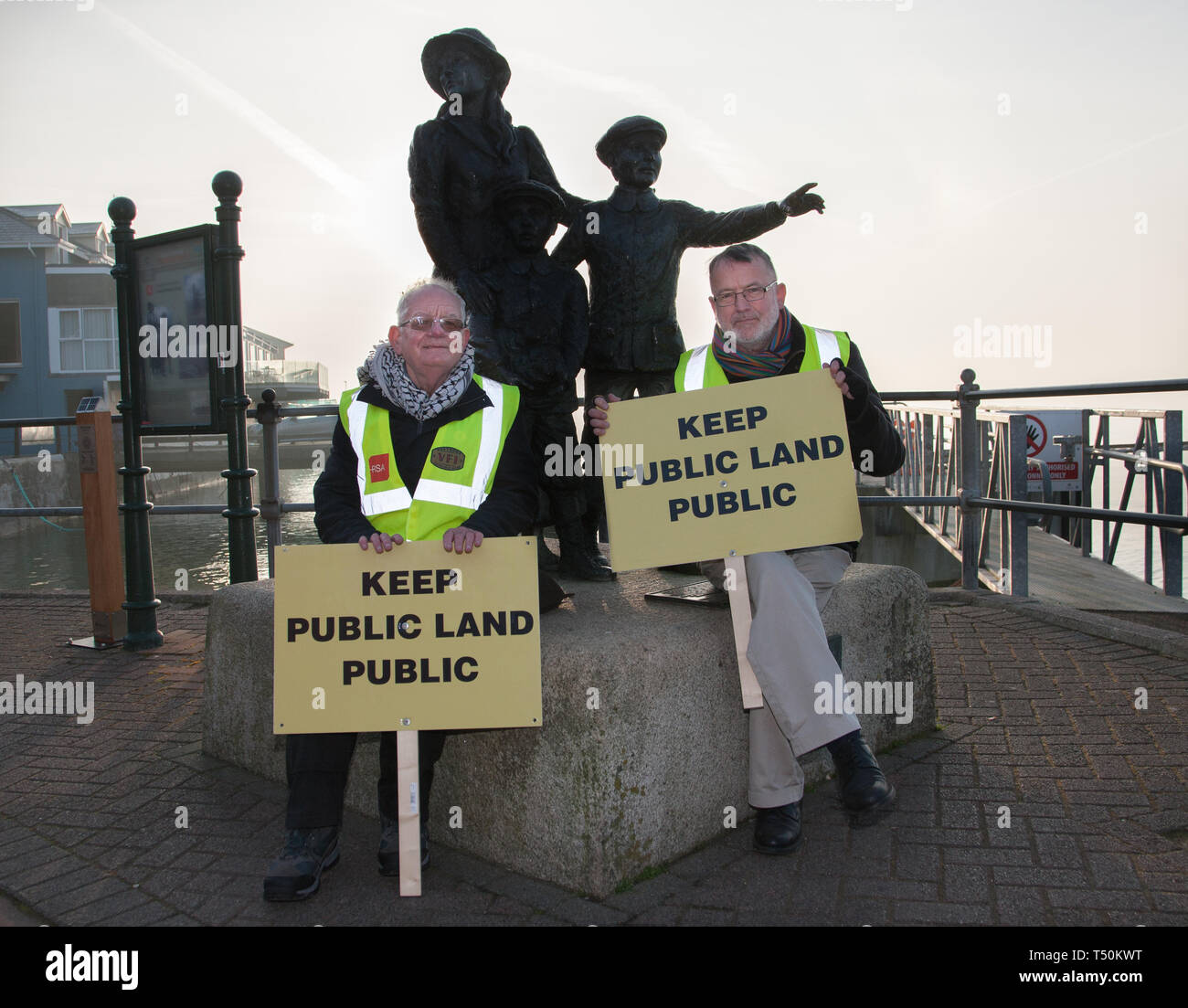 Cobh, Cork, Ireland. 20th April, 2019. On the arrival of the liner Saga Sapphire,  Cllr Diarmaid Ó Cadhla and Tony Cronin protest at the decision by the Port of Cork company to close the quayside public walk during the arrival of cruise liners in Cobh, Co. Cork, Ireland. Credit: David Creedon/Alamy Live News Stock Photo
