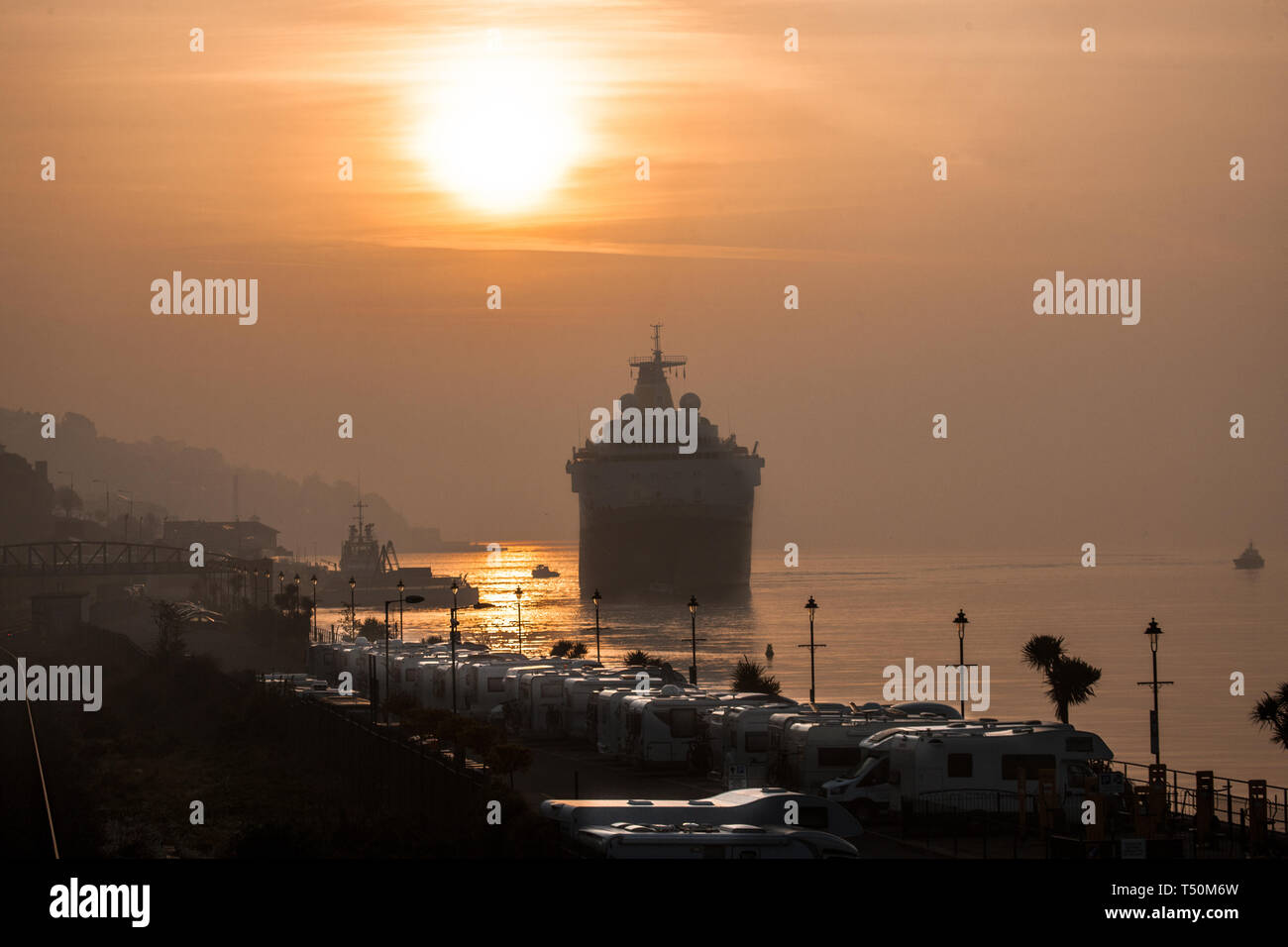 Cobh, Cork, Ireland. 20th April, 2019. Cruise liner Saga Sapphire arrives in Cobh, Co. Cork just after sunrise for a short visit to the coastal town. Credit: David Creedon/Alamy Live News Stock Photo