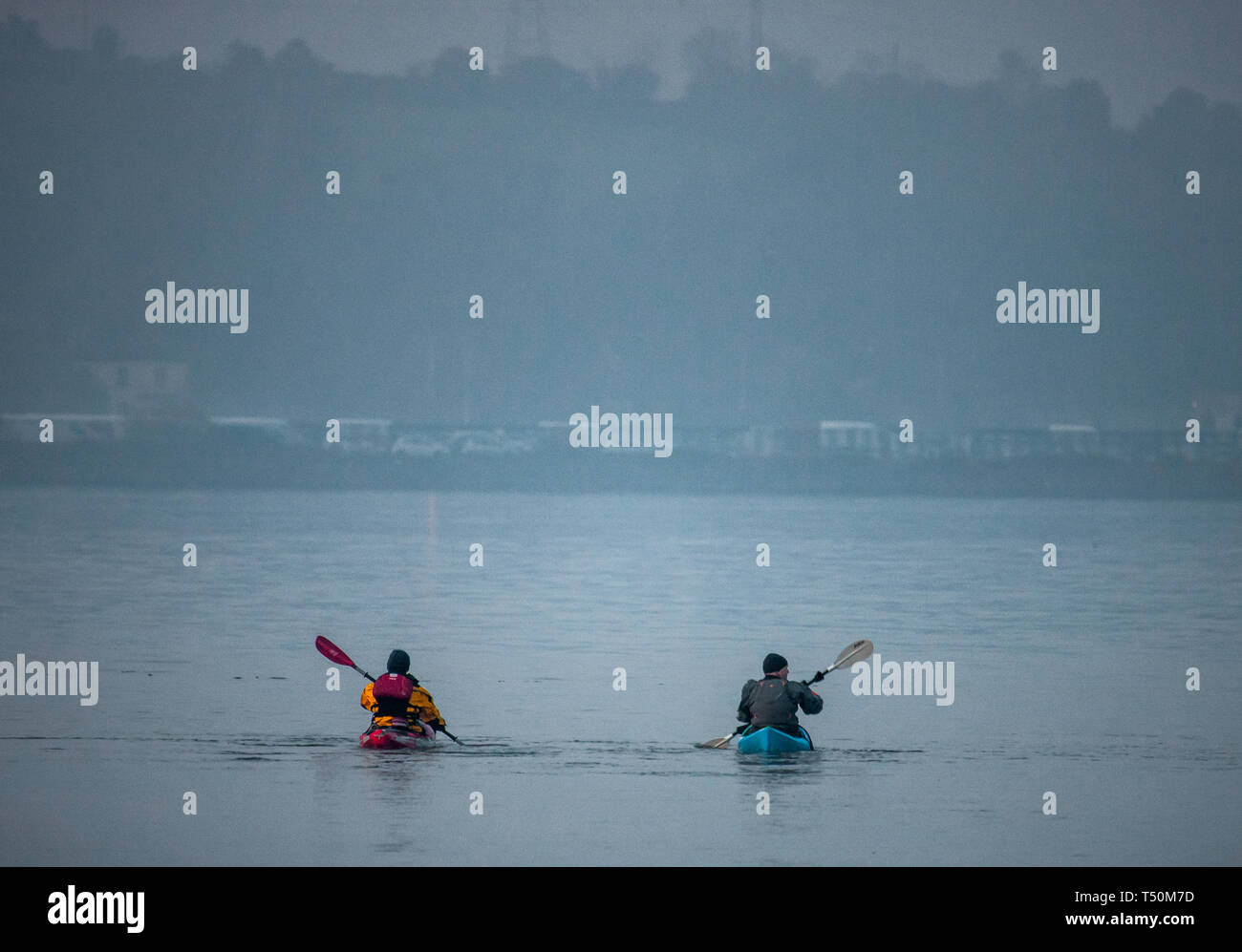 Cobh, Cork, Ireland. 20th April, 2019. Two Canoes set off on a foggy morning from Cobh, for a paddle in up the river in Cork, Ireland. Credit: David Creedon/Alamy Live News Stock Photo