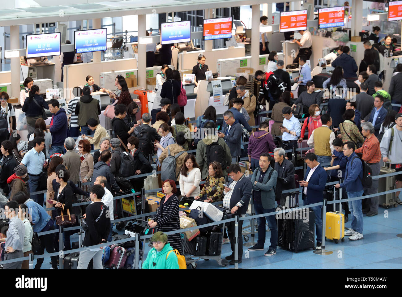 Tokyo, Japan. 19th Apr, 2019. The international terminal of Tokyo's Haneda airport is crowded with tourists to travel abroad on Friday, April 19, 2019. Japan will have ten-day Golden Week holidays from April 27 through May 6 since Emperor Akihito will abdicate on April 30 and Crown Prince Naruhito will ascend the throne on May 1. Credit: Yoshio Tsunoda/AFLO/Alamy Live News Stock Photo