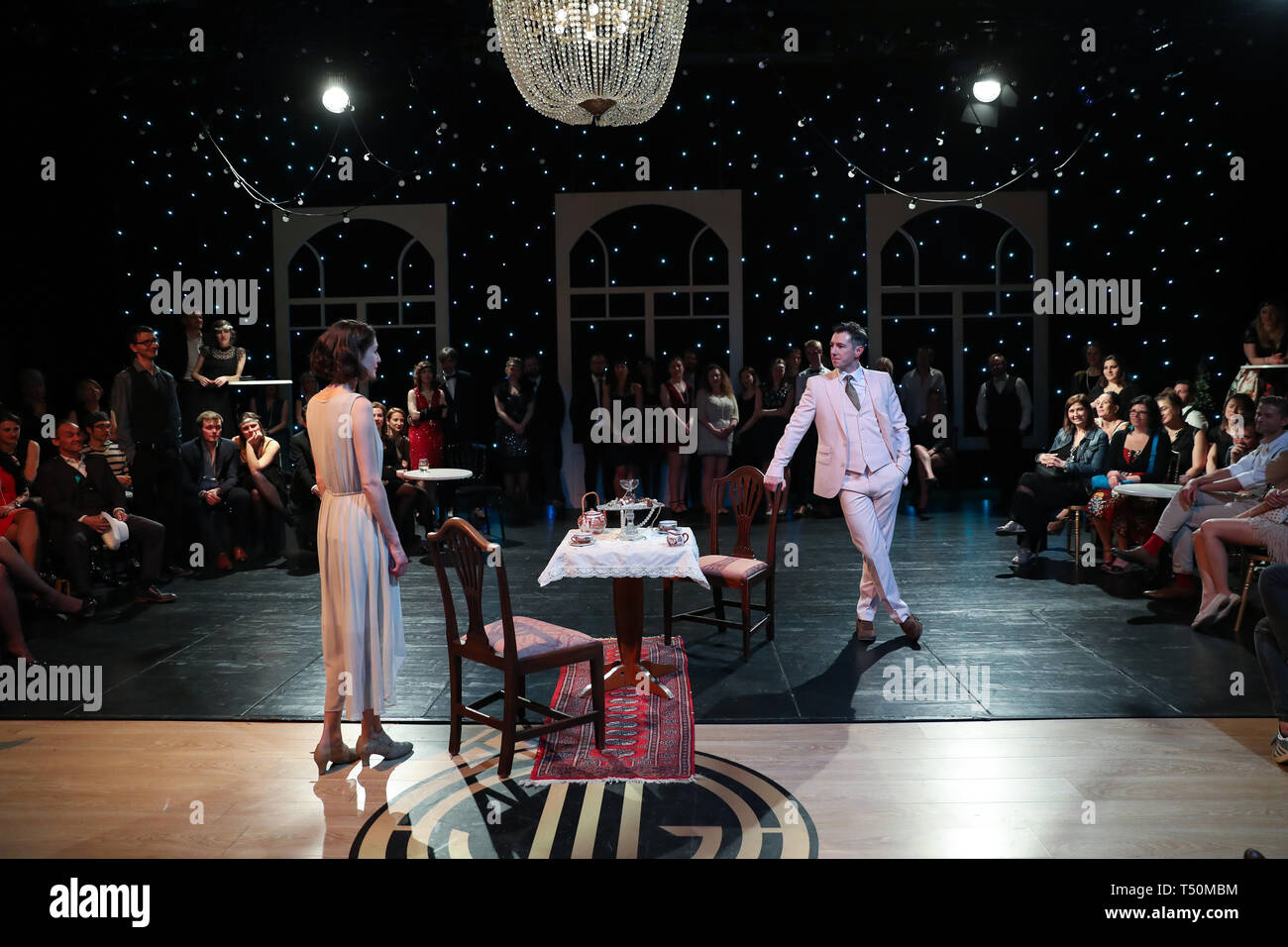 Brussels, Belgium. 19th Apr, 2019. An actor plays Jay Gatsby (R) while an actrees plays Daisy Buchanan during The Great Gatsby Immersive Show in Brussels, Belgium, April 19, 2019. By merging musical and stage play, The Great Gatsby Immersive Show is adapted from American author F. Scott Fitzgerald's 1925 novel 'The Great Gatsby', allowing the audience to dive deep into a world of the 1920s known as the Roaring Twenties. Presented alternately in Dutch, French and English, the show kicked off on March 14 and will last until May 19. Credit: Zhang Cheng/Xinhua/Alamy Live News - Stock Image