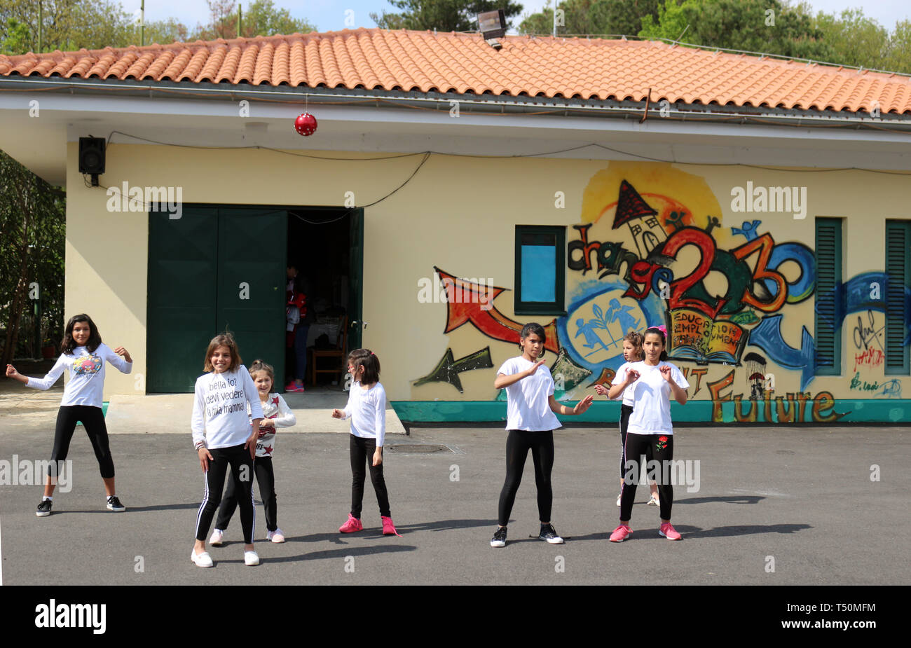 17 April 2019, Albania, Tirana: Children dance in the courtyard of the SOS Children's Village in Tirana. The SOS Children's Village in the suburb of Sauk in the southeast of Tirana lives from the support of the SOS organisations in Germany and Austria as well as from donations from domestic companies. (to give dpa KORR children a family - SOS Children's Villages will 70 from 19.04.2019) Photo: Gregor Mayer/dpa - Stock Image