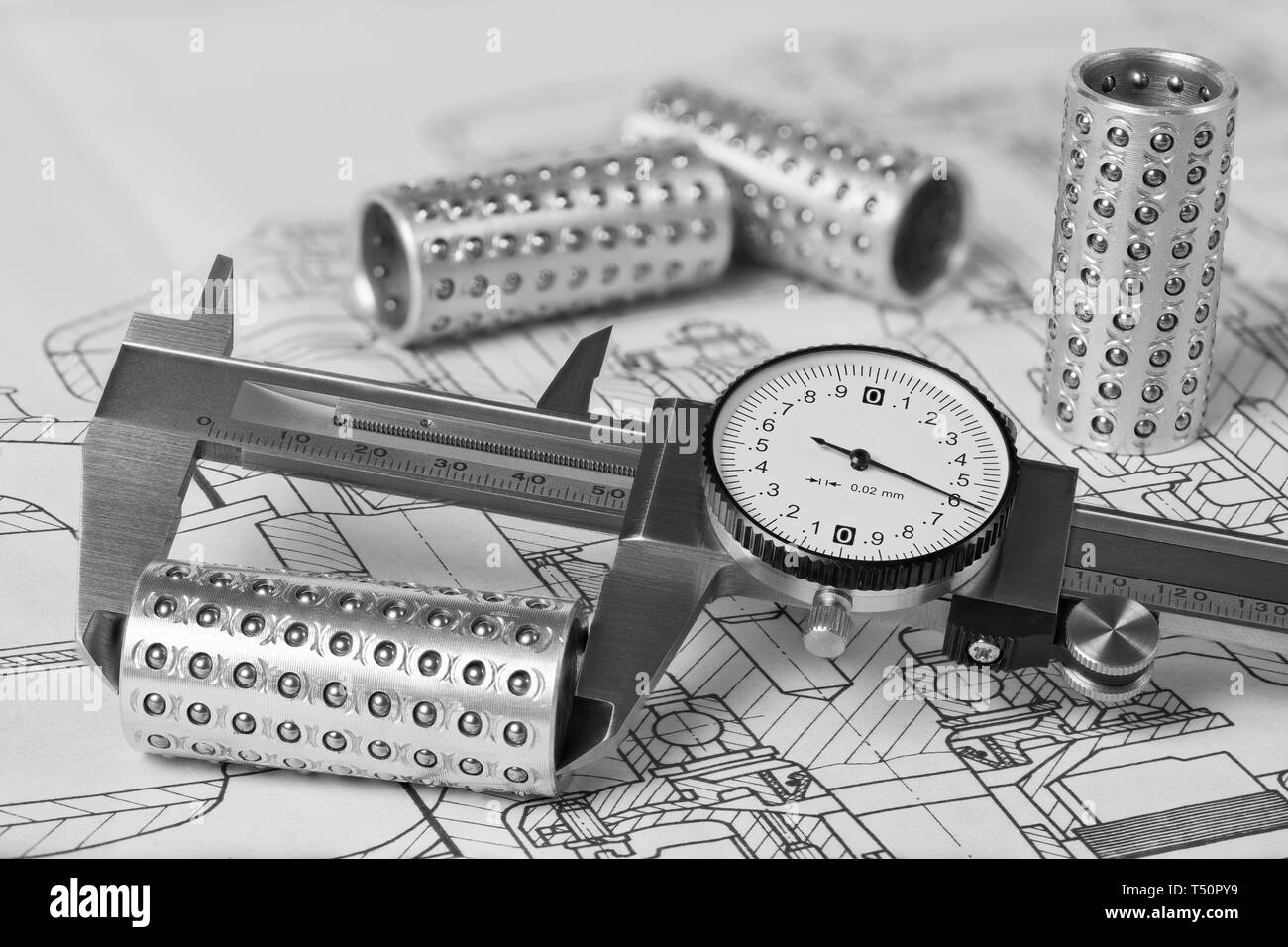 Caliper. Linear ball bearings. Plan. Measuring of metal rollers. Technical drawing. Metallic gauge with vernier scale and round dial. Steel part group. - Stock Image