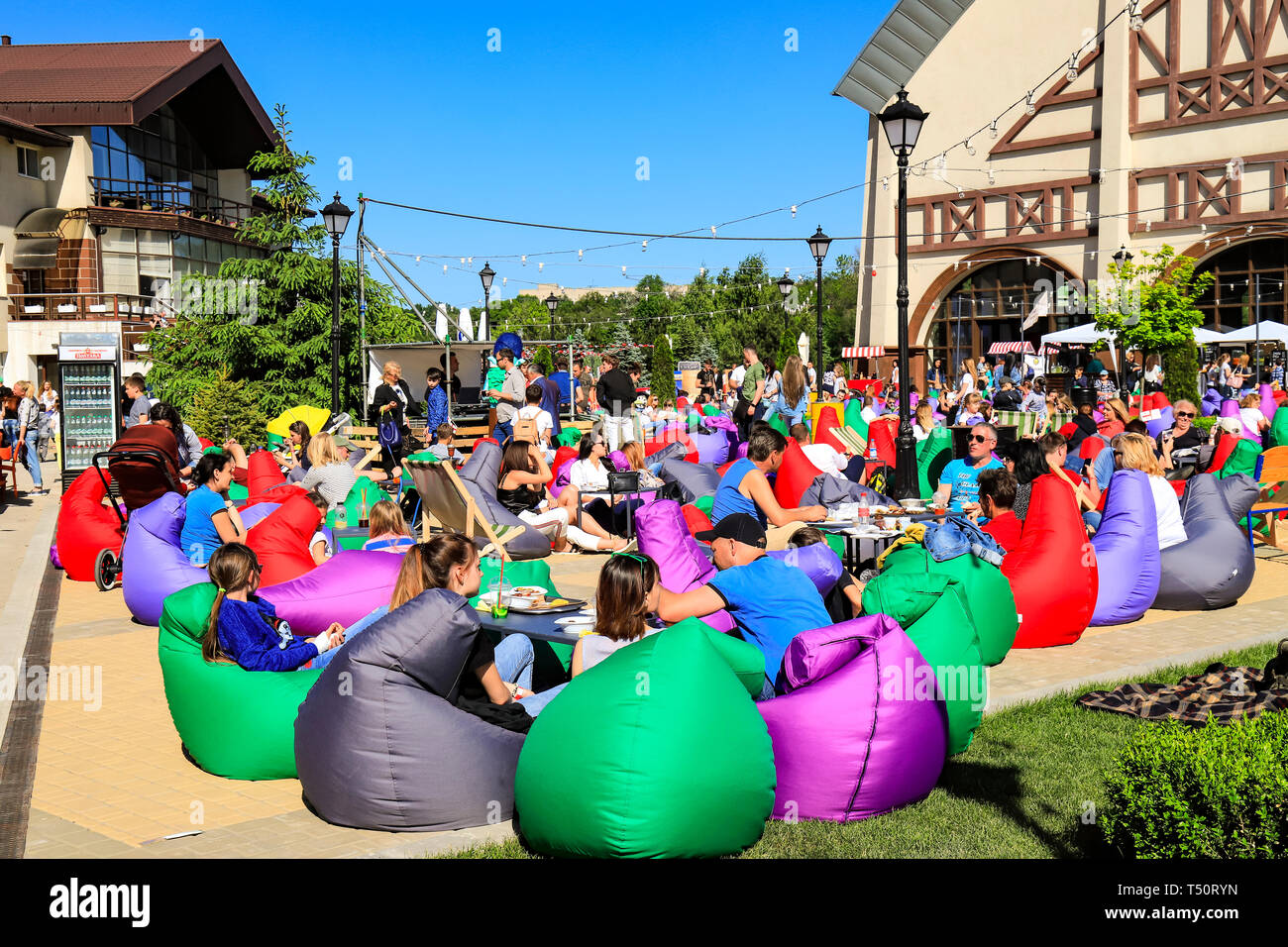 Dnepr city, Ukraine. May 28, 2018. People rest on colors chairs during the festival of food in spring, summer. Armchair bag. Dnepropetrovsk - Stock Image