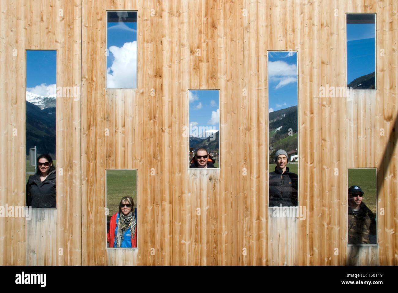 Fun with friend at ErlebnisSennerei Zillertal cheese farm in Mayrhofen, Austria - Stock Image