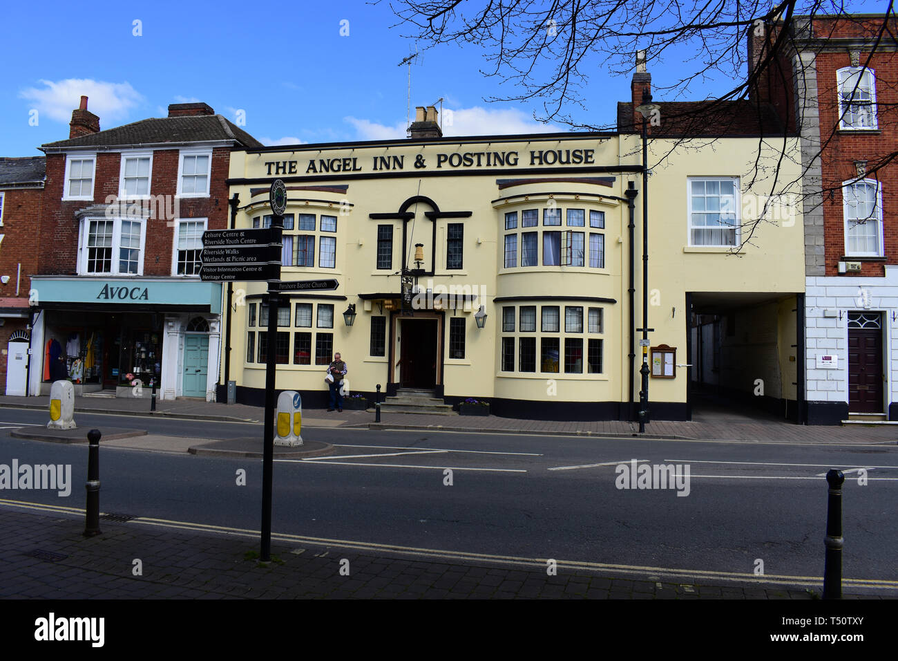 The Angel Inn & Posting House is an old coaching inn,dating back to Tudor times.Once also a posting house for distributing mail after arrival by coach - Stock Image