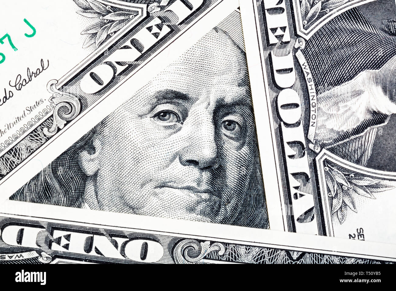 Benjamin Franklin on the one hundred dollar bill framed by other banknotes. - Stock Image