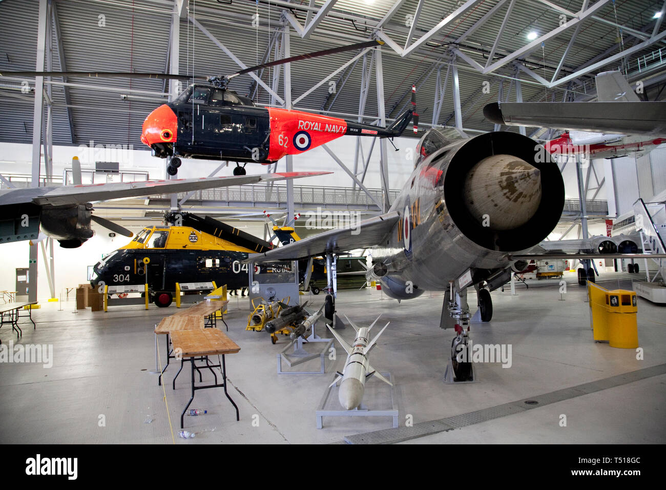 American Air Museum at Duxford Imperial War Museum,Cambridgeshire, England. English Electric Lightning F.1,Westland Whirlwind HAS.7 - Stock Image