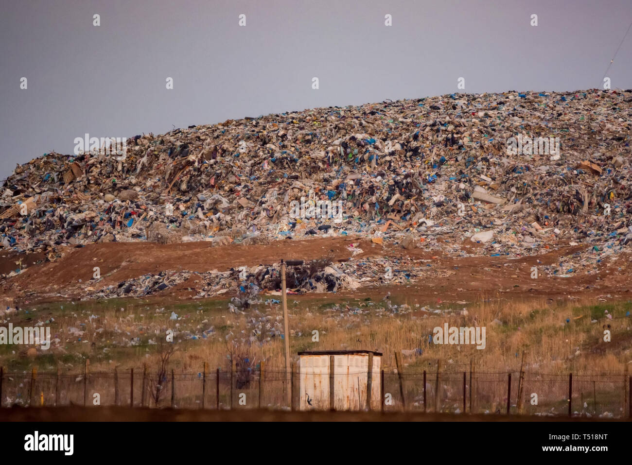 View of a big landfill outside the city behind the gate - Stock Image