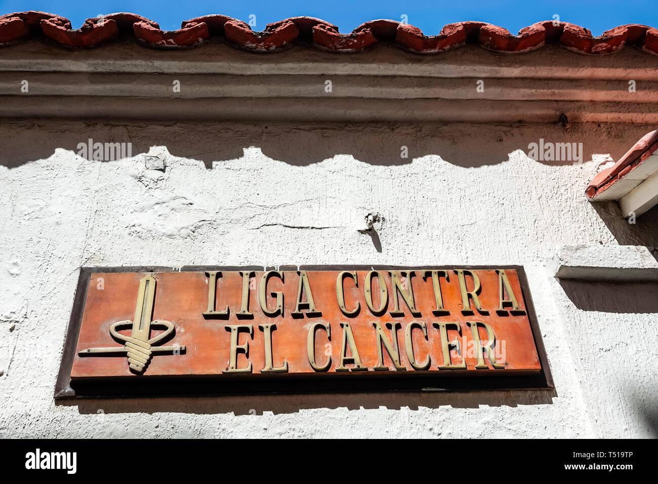 Cartagena Colombia Old Walled City Center centre Centro Liga Contra El Cancer anti-cancer league nonprofit sign - Stock Image