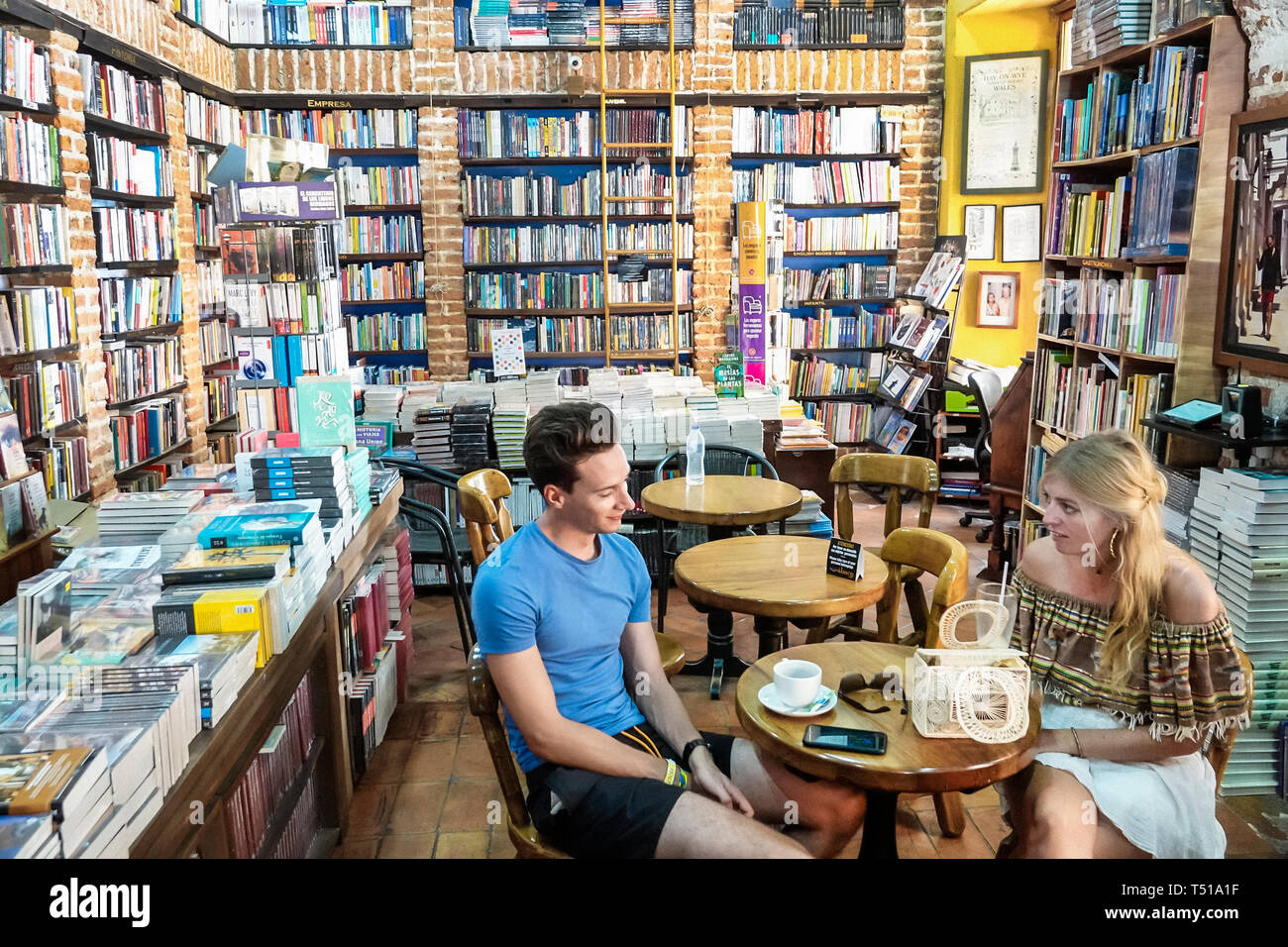 Cartagena Colombia Old Walled City Center centre Centro Abaco Libros y Cafe Abacus bookstore cafe interior bookshelf bookshelves exposed brick table d Stock Photo