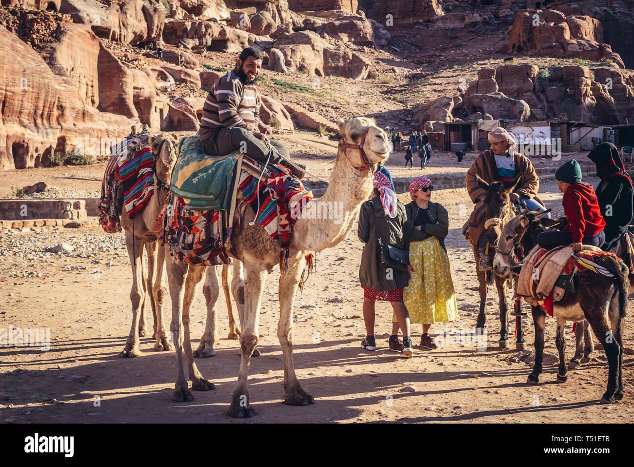 Camels in Petra historical city of Nabatean Kingdom in Jordan Stock Photo