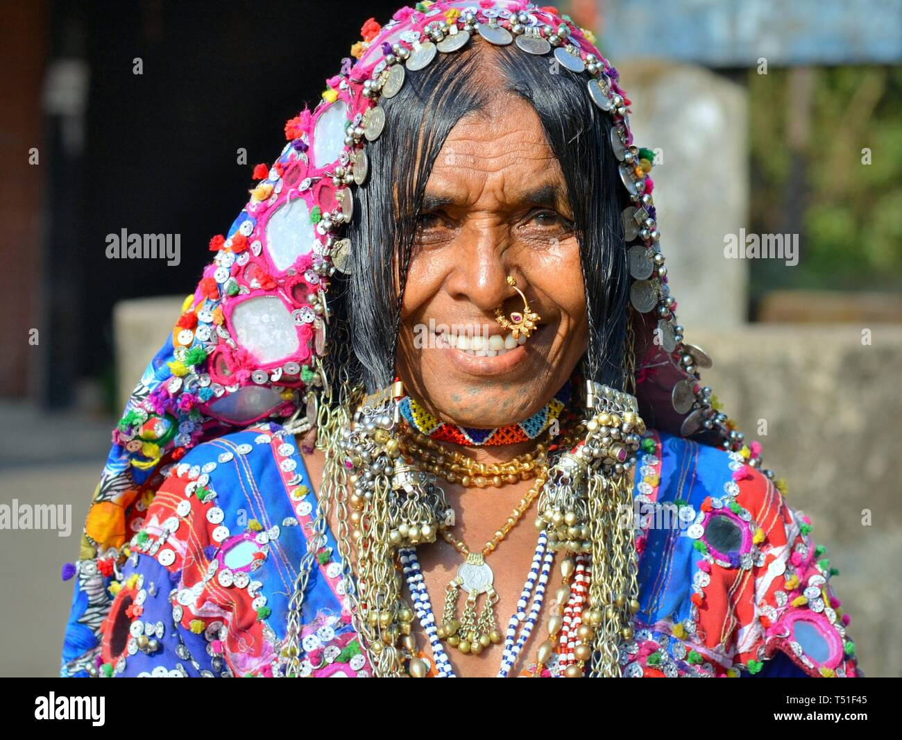 Elderly Indian Lambani tribal woman from Karnataka (Banjara woman, Indian  gypsy) with traditional chin tattoos and nose jewelry smiles for the camera  Stock Photo - Alamy