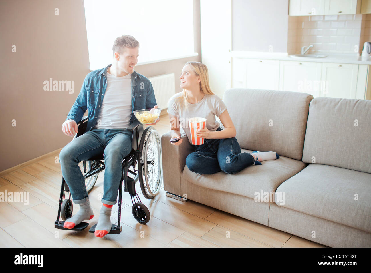 Pleasing Young Man With Disability Sitting Beside Woman On Sofa They Onthecornerstone Fun Painted Chair Ideas Images Onthecornerstoneorg
