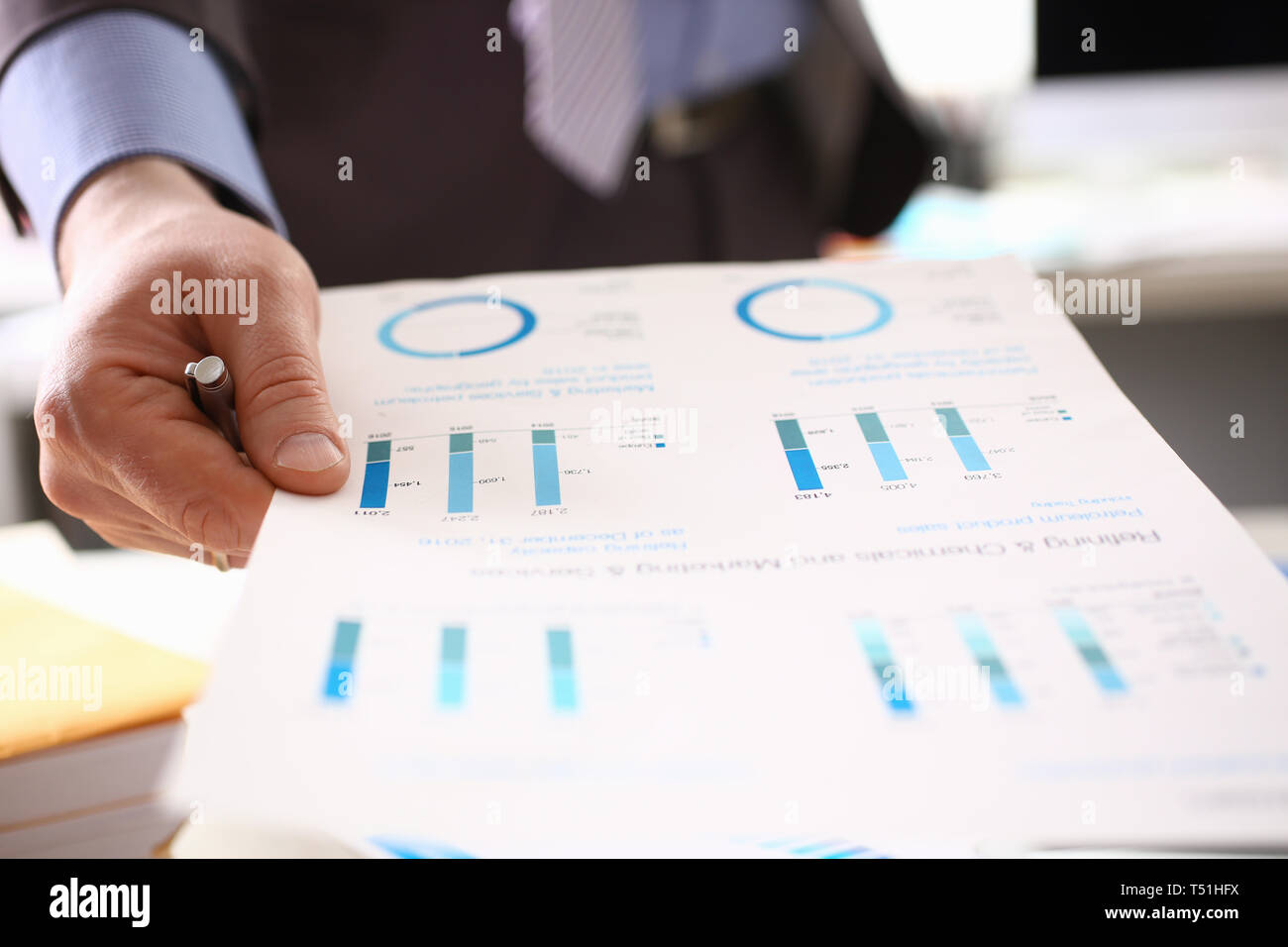 Auditor Calculating Tax Income Using Business Data - Stock Image